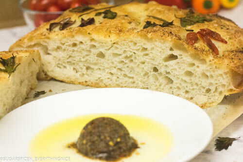 sliced focaccia with dip on side