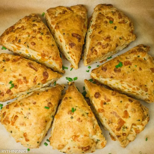 8 cheddar and chive scones kept in a circle