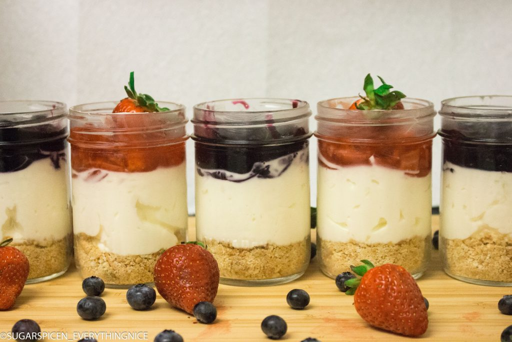 cheesecake in a jar with bluberry and strawberry toppings