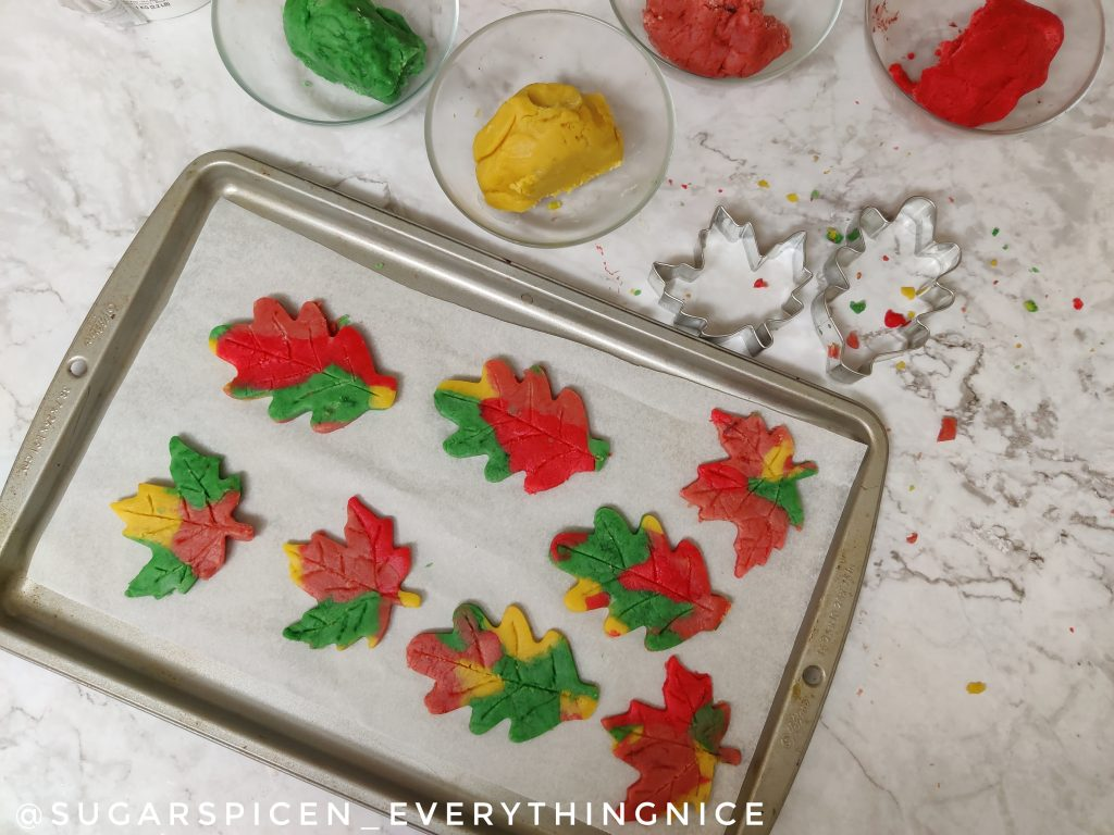 Dough cut out in in shape of maple leaves placed on a baking tray