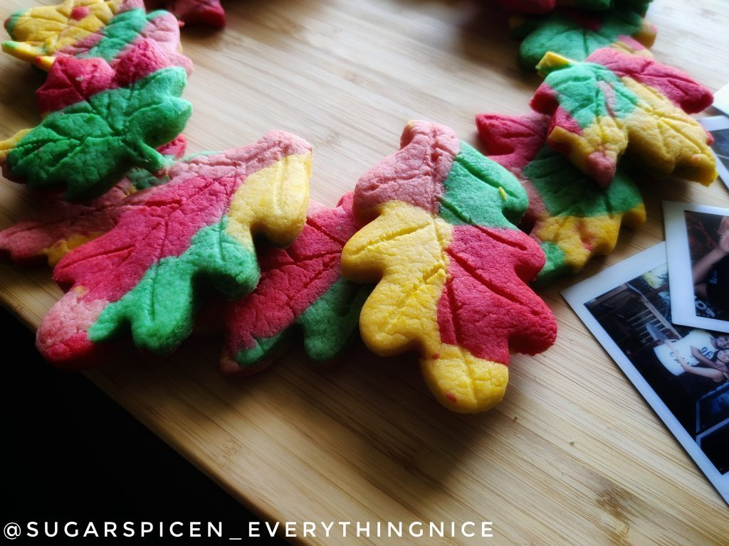 fall leaf cookies on a wooden board