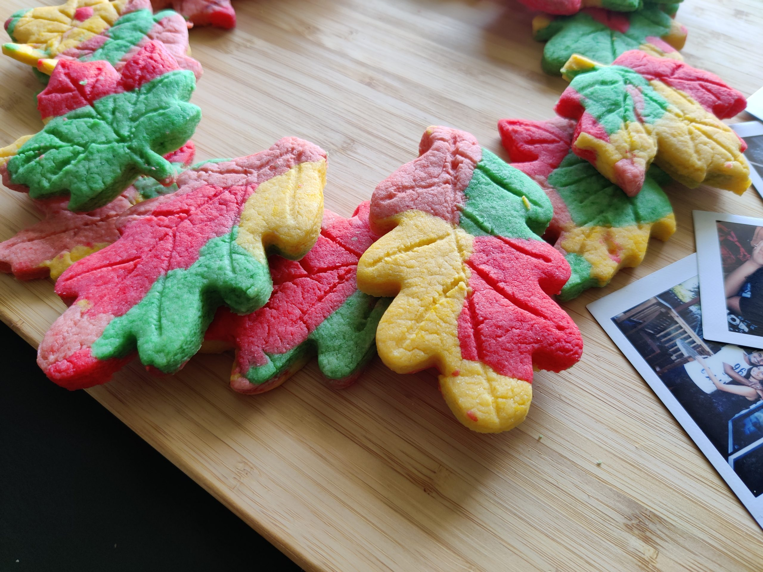 Maple leaf shaped & colored cookies placed laid out as a wreath