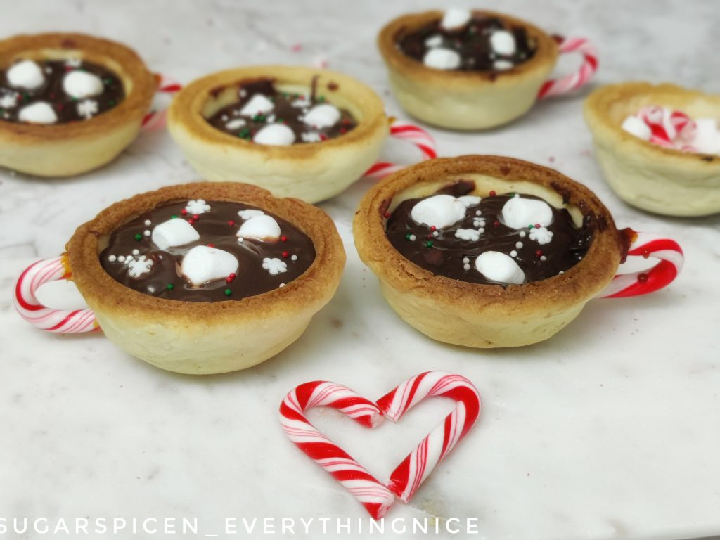 2 hot chocolate cookie cups and a candy cane heart