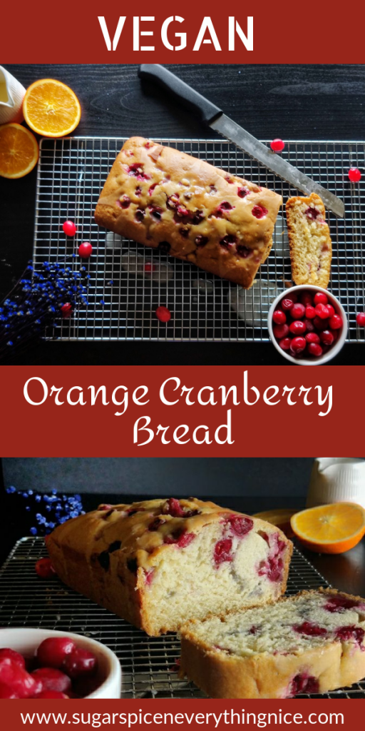 cranberry orange bread with a slice cut out and a bowl of cranberries kept on the side