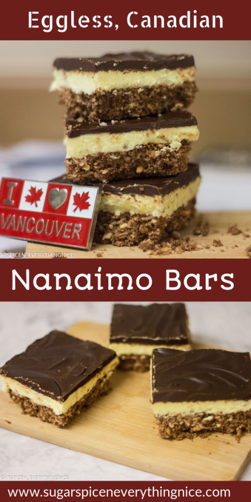 I love Vancouver magnet is leaning against stack of 3 Nanaimo bars. 3 Nanaimo bars kept o a cutting board