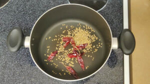 coriander seeds and bay leaf added to heat pot