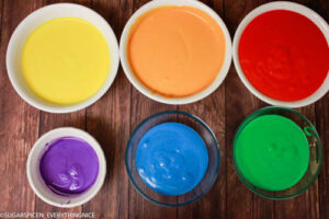 different colored batter placed in bowls