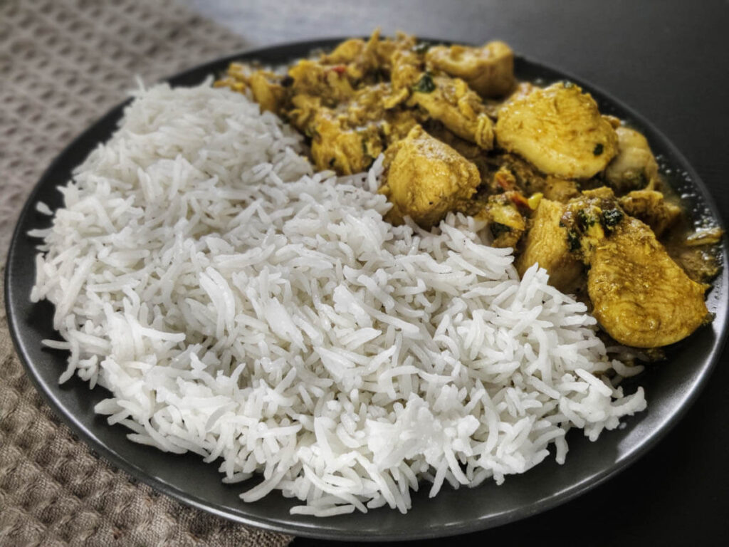 white basmati rice made in instant pot and chicken salan on the same plate